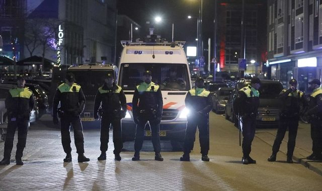 Police block off the street outside the Turkish consulate in Rotterdam where a crowd gathered to welcome the Turkish Family Minister Fatma Betul Sayan Kaya, who decided to travel to Rotterdam by land after Turkish Foreign Minister Mevlut Cavusoglu's flight was barred from landing by the Dutch government, in Rotterdam, Netherlands March 11, 2017.     REUTERS/Yves Herman